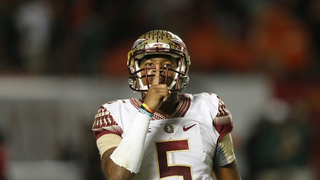 FSU's Jameis Winston silences the crowd at Sun Life Stadium when the Seminoles came back to defeat the University of Miami 30-26.