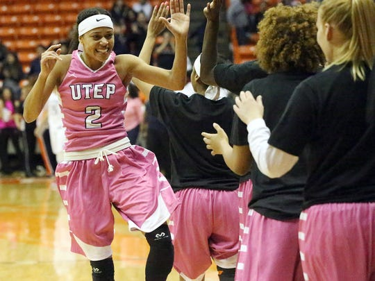 Cameasha Turner (2) celebrates the Miners' 70-64 win over Old Dominion on Thursday night in the Don Haskins Center.