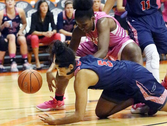 UTEP's Tamara Seda top, goes after a loose ball with