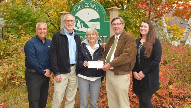 Tom Clay, left, Door County Land Trust director, Russ and Deb Feirer of the Chambers Island nature preserve committee, Rob Van Gemert, Cellcom business sales manager and Amanda Pyke, land stewardship manager