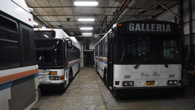 Buses sit at the city of Poughkeepsie Central Garage before they were transferred to Dutchess County.