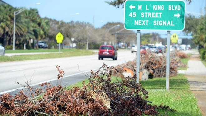Piles of branches and debris left over from Hurricane Irma Tuesday, Sept. 26, 2017, still line U.S. 1 in Indian River County. County officials estimate that 100,000 cubic yards of yard waste was generated by Hurricane Irma in the unincorporated parts of the county.