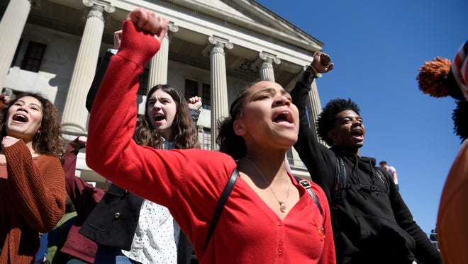 Yaniece Norwood stands on the steps of the Capitol with Hume Fogg students participating in the the National School Walkout event Wednesday, March 14, 2018 in Nashville, Tenn. The event marks the one-month anniversary of the shooting at Marjory Stoneman Douglas High School in Parkland, Fla.