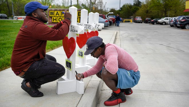 Hadari and Lancelot DaSilva sign the memorial for their cousin Akilah DaSilva who was one of the four people killed   at the Waffle House last Sunday in Antioch, Tenn., Wednesday, April 25, 2018.