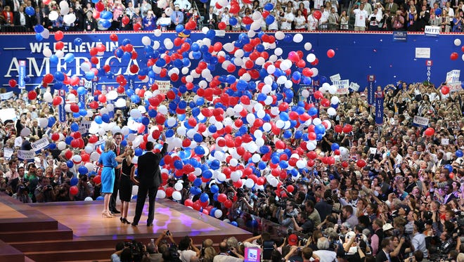 In this 2012 file photo, then-Republican presidential candidate Mitt Romney and vice presidential candidate Paul Ryan are on stage with their wives Ann Romney and Janna Ryan at the end of the Republican National Convention in Tampa, Fla.