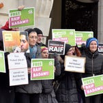 Members of the Austrian Greens attend a protest Feb. 6, 2015, by the Austrian Greens against the punishment for Saudi blogger Raif Badawi in front of the KAICIID in Vienna, Austria.