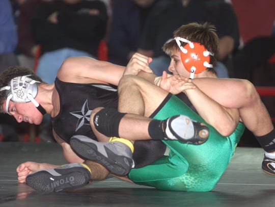 Mike Molosky of Pinelands (right) try to gain control
