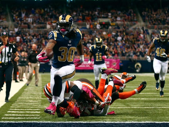 Todd Gurley #30 of the St. Louis Rams scores a touchdown in the fourth quarter against the Cleveland Browns at the Edward Jones Dome on October 25, 2015 in St. Louis, Missouri.