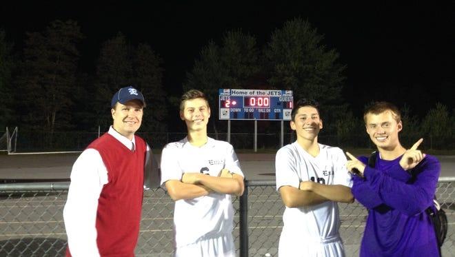 Enka soccer coach Jason McGill, left, and his team captains.