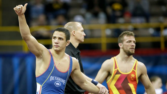 Aaron Pico (left) reacts after beating Reece Humphrey in their 143-pound  freestyle match at the U.S. Olympic wrestling team trials April 9, 2016, in Iowa City, Iowa.