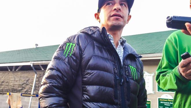 Victor Espinoza stopped for interviews Monday at Churchill Downs.