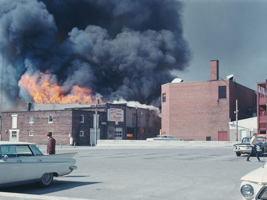 Fire spreads through buildings on the east side of