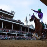 California Chrome jockey Victor Espinoza pulls away for a dominant victory at the Kentucky Derby. Long shot Commanding Curve rallied for second, with Danza third.