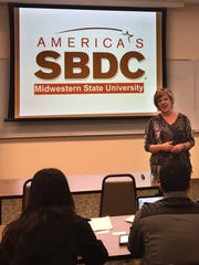 In this file photo, Vanda Cullar, director of America's SBDC at Midwestern State University, speaks to contestants during small-business plan workshop as part of IdeaWF, a program that encourages entrepreneurship. Creating a business plan is part of the competition, and there are specific requirements competitors must meet. This year's 14 semi-finalists will continue through another round of workshops in May before submitting a final business plan in August.