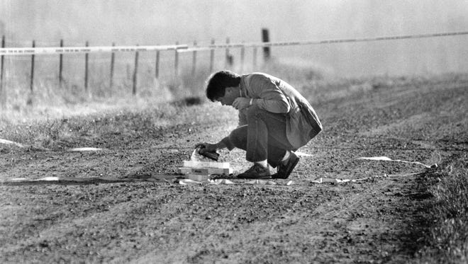 An investigator marks the location of footprints and tire tracks near the spot where Jacob Wetterling was abducted in 1989.