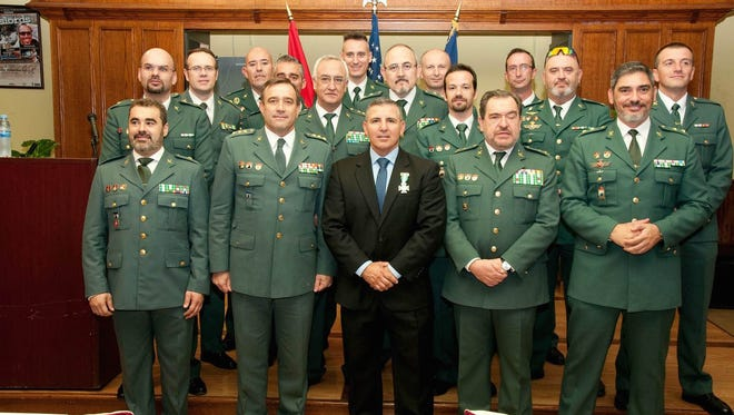 Pictured is Jose Luna at center, posing with high ranking officers of the Spanish Guardia Civil in Spain, during his award ceremony.