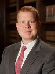 Defense attorney Adam Woody
