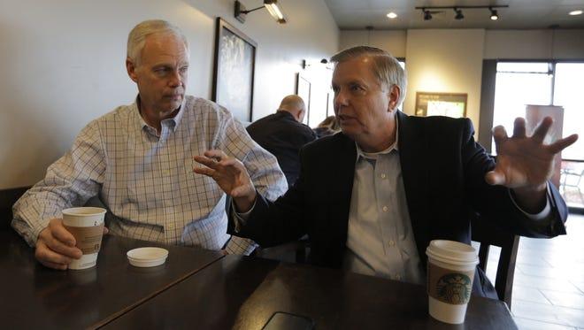 U.S. Sens. Ron Johnson of Oshkosh and Lindsey Graham of South Carolina talk with USA TODAY NETWORK-Wisconsin Thursday, Oct. 27, 2016, at Starbucks on South Koeller Street in Oshkosh.