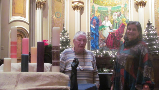 Muriel Spagnolli of Binghamton, left; and Rev. Kimberly Chastain, pastor of United Presbyterian Church of Binghamton; stand inside the church sanctuary. The church will hold a blue Christmas service on Dec. 13 for those who may be grieving a loss during the holiday season.