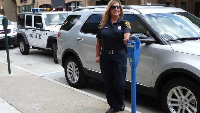 Birmingham began installing some 70 handicap-accessible parking spaces over the weekend.