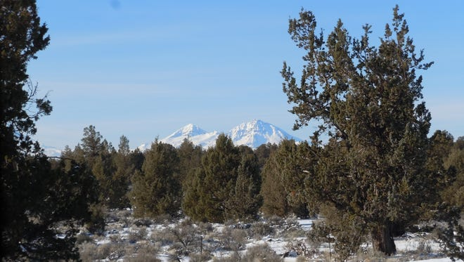 This Dec. 11, 2013 photo shows the Cascade Mountains in the Cline Buttes Recreation Area Northwest of Bend, Ore. (AP Photo/The Bulletin)