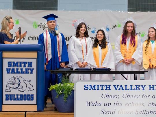 Principal Kathy Bomba-Edgerton applauds the graduating