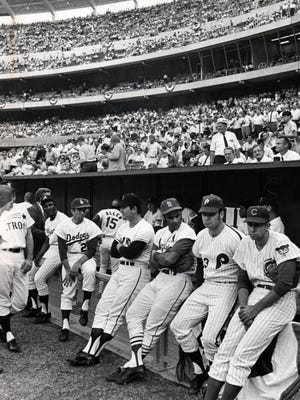 National League players take a breather before the 1970 All-Star Game played in Riverfront Stadium. The National League won 5-4 in 12 innings.