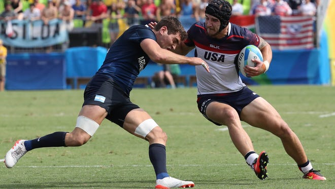 Argentina forward German Schulz (3) tries to make a tackle on United States forward Garrett Bender (4) during a rugby sevens match between the USA and Argentina on Tuesday at Deodoro Stadium in the Rio 2016 Summer Olympic Games.