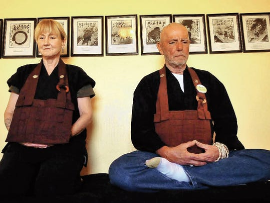 The Rev. Kathryn Shukke Hilbert, abbot of the Daibutsuji Zen Center of Las Cruces, and abbot emeritus, the Rev. Harvey Daiho Hilbert meditate in a room in their home dedicated to their practice.