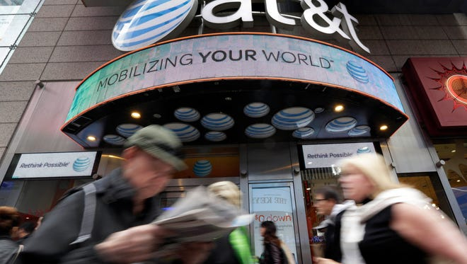 An AT&T store in New York's Times Square. AT&T is being sued by the government over allegations it misled millions of smartphone customers who were promised unlimited data but had their Internet speeds cut by the company, slowing their ability to open Web pages or watch streaming video.