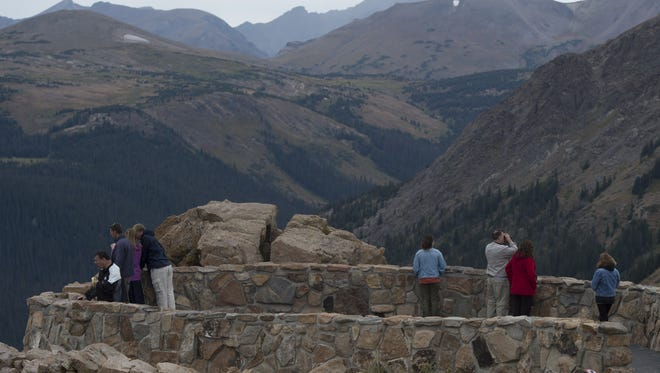 Visitors take in the views from the Forest Canyon overlook near Trail Ridge Road in Rocky Mountain National Park September 4, 2015.