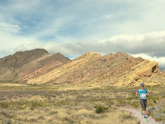 A person goes for a run on the Sierra Vista Trail.