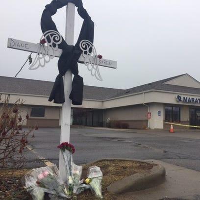 Slain bank employees remembered for kindness, giving spirits