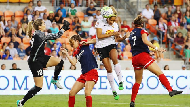 Lynn Williams #9 of the Western New York Flash scores a header past Kelsey Wys #18 of the Washington Spirit during the second half of the 2016 NWSL Championship at BBVA Compass Stadium on October 9, 2016 in Houston, Texas.