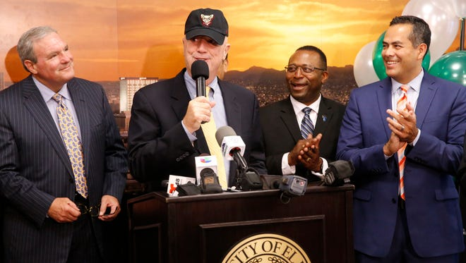 Michael Pewther, Frontier Airlines senior director of onboard experience, wears an El Paso Chihuahuas baseball cap as he speaks while El Paso Mayor Dee Margo, left, city Rep. Sam Morgan and City Manager Tommy Gonzalez listen at a news conference Tuesday announcing new, nonstop flights from El Paso to Chicago, in addition to previously announced nonstop flights to Denver.