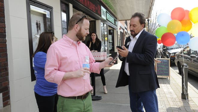Fans use smartphones to vote for Franklin as Garden & Gun's Greatest Southern Town during a social media rally Wednesday at the Franklin Theatre.
