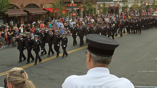 Fire departments and marching bands  take part in the annual Mamaroneck Fire Department parade along Mamaroneck Avenue.