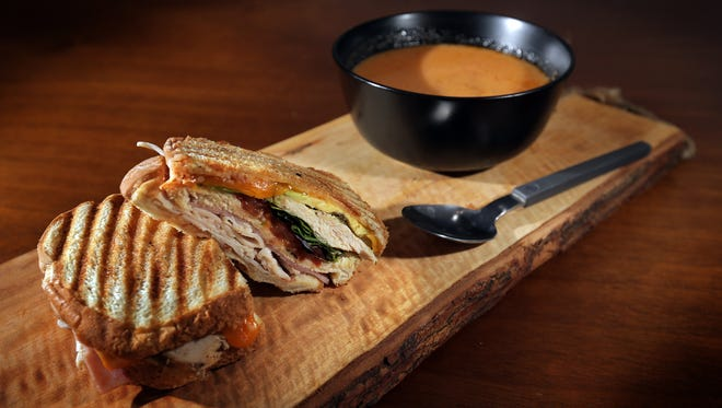 The pesto chicken panini and a bowl of tomato and smoked bacon bisque from NY Deli, 702 Myrtle Ave.