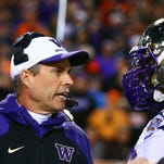 Chris Petersen, who guided Boise State to a 92-12 record in 13 seasons as head coach, brings his Washington team to the Broncos' blue turf in Boise, Idaho, on Friday night.