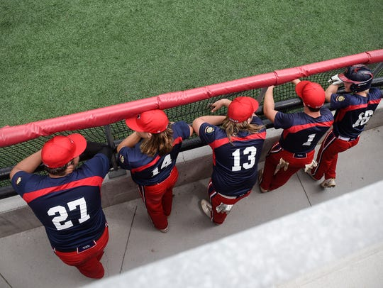 St. Cloud 76ers watch from the dugout during a game