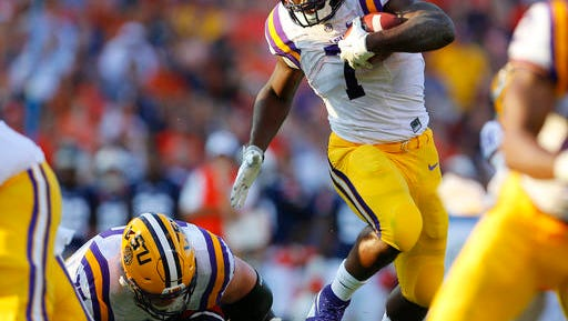 LSU running back Leonard Fournette (7) hurdles an Auburn player as he carries the ball during the first half of an NCAA college football game, Saturday, Sept. 24, 2016, in Auburn, Ala. (AP Photo/Butch Dill)
