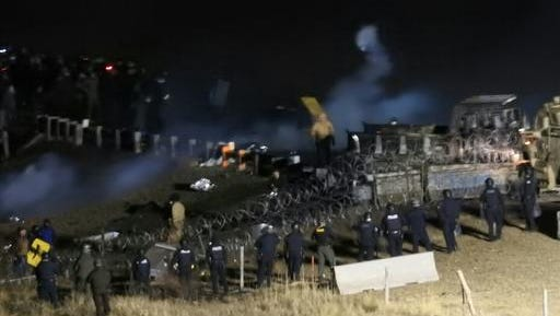 In this image provided by Morton County Sheriff's Department, law enforcement and protesters clash near the site of the Dakota Access pipeline on Sunday, Nov. 20, 2016, in Cannon Ball, N.D. The clash came as protesters sought to push past a bridge on a state highway that had been blockaded since late October, according to the Morton County Sheriff's Office.