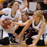 Sauk Centre senior Madison Greenwaldt (1) battles Norwood-Young America's Abby Mackenthun (20) and Morgan Karnes (10) for possession during the second half of the Class 2A girls basketball tournament quarterfinal game Wednesday at the University of Minnesota's Mariucci Arena in Minneapolis. The Mainstreeters victory over Norwood-Young America sends Sauk Centre to Friday's semifinal game at Williams Arena.