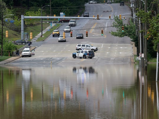 Police block a flooded road in Raleigh, N.C., Tuesday,