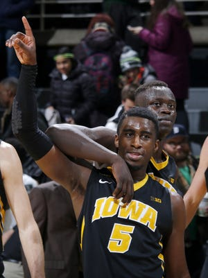 """Iowa's Anthony Clemmons (5) and Peter Jok celebrate a 76-59 win over Michigan State Thursday in East Lansing. """"The key for us will be to come out Sunday with the same focus and determination,"""" coach Fran McCaffery said."""