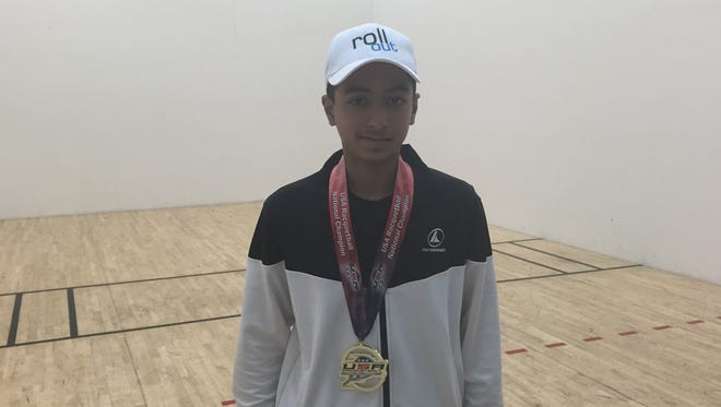 Akul Ramayani, 14, a decorated racquetball player, poses for a photo on Monday.