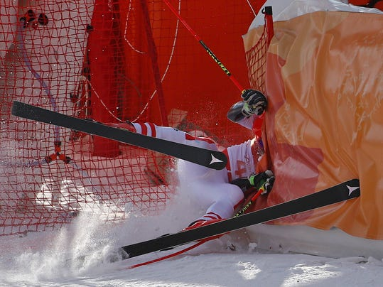 Austria's Manuel Feller crashes during the first run of the men's giant slalom at the 2018 Winter Olympics in Pyeongchang, South Korea, Sunday, Feb. 18, 2018. (AP Photo/Christophe Ena)