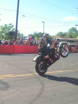 Busted Knuckles Stunt Tour, Genuine American Daredevils, performing motorcycle stunts at Blues Fest in Silver City.