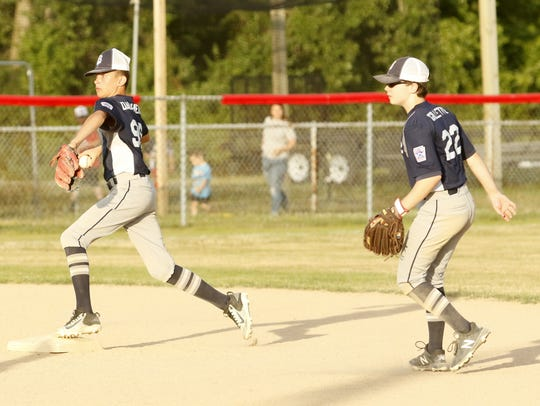 Big Flats shortstop Alex Daugherty steps on second