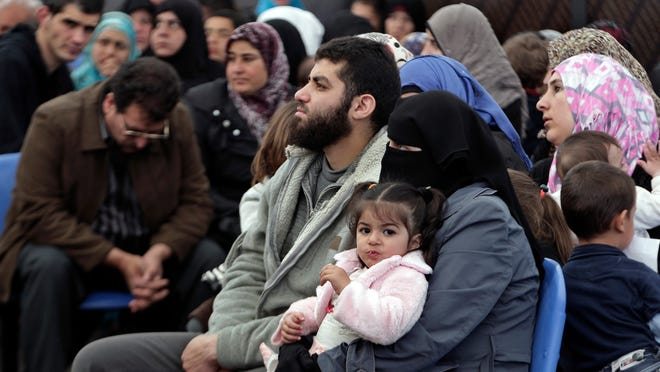 Syrian families await their turn to register at the United Nations High Commissioner for Refugees (UNHCR) center in the northern city of Tripoli, Lebanon.